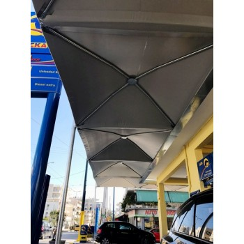 στεγαστρα αυτοκινητων - στεγαστρο τυπου ομπρελασ με PVC